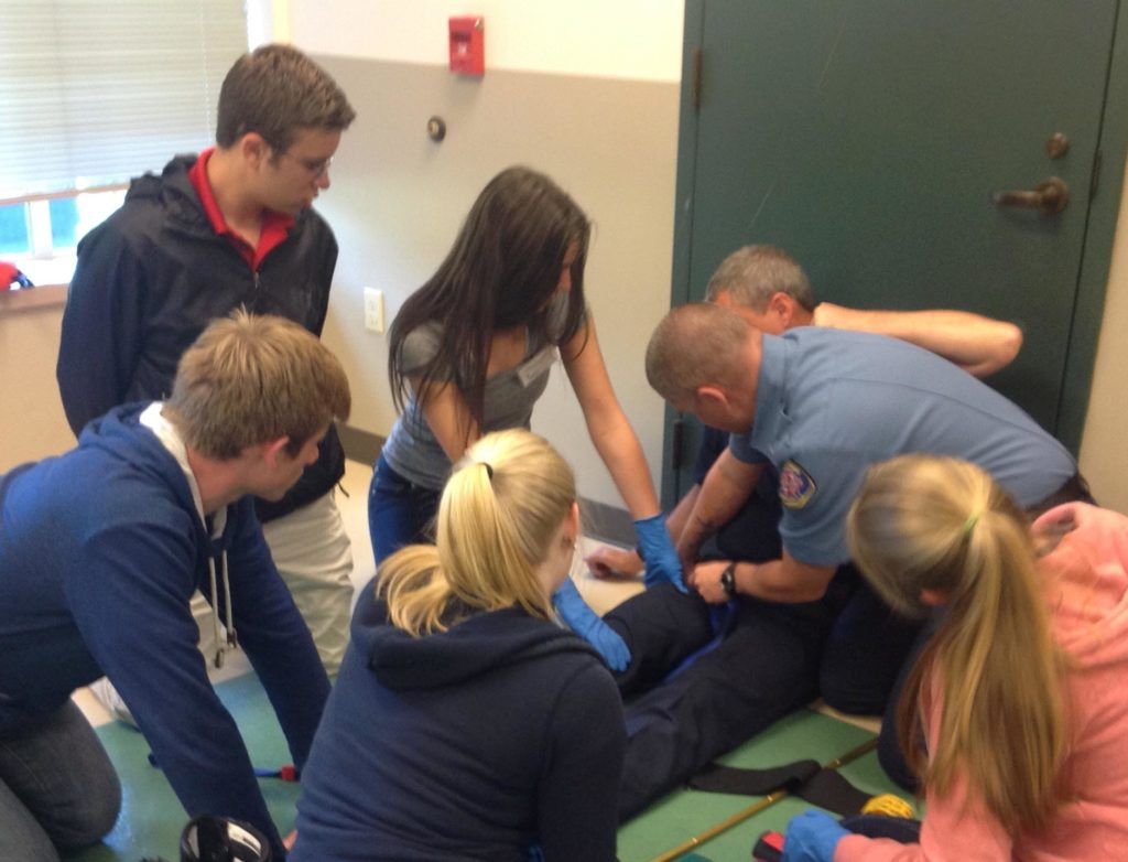 Students learning about emergency medical response