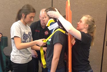 Students setting neck brace