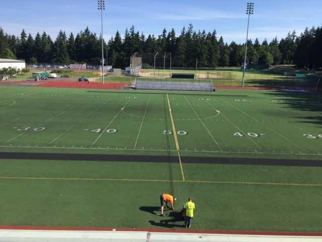 Workers cutting turf